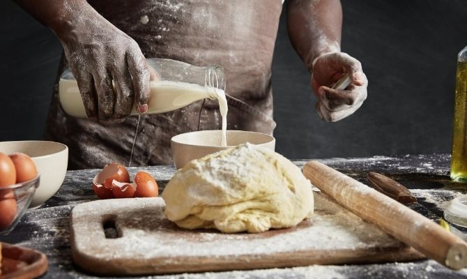 Baker working with dough